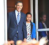 United States President Barack Obama, left, accompanied by his daughter Sasha, right, arrives at he ceremony to pardon the National Thanksgiving Turkey, Liberty, in a  ceremony on the North Portico of the White House in Washington, D.C. on Wednesday, November 23, 2011.  Liberty, a 19-week old, 45-pound Turkey will live out its life at George Washington's Mount Vernon Estate and Gardens in Mount Vernon, Virginia. .Credit: Ron Sachs / CNP.(RESTRICTION: NO New York or New Jersey Newspapers or newspapers within a 75 mile radius of New York City)