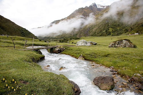 THE RIO BLANCO WINDS ITS WAY THROUGH THE HIGH SLOPES OF THE PERUVIAN ANDES