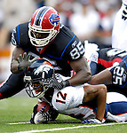 9 September 2007: Denver Broncos wide receiver Domenik Hixon (12) is tackled by Buffalo Bills' tight end Kevin Everett (85) at Ralph Wilson Stadium in Buffalo, NY. The Broncos defeated the Bills 15-14 in the opening day matchup...Mandatory Photo Credit: Ed Wolfstein Photo