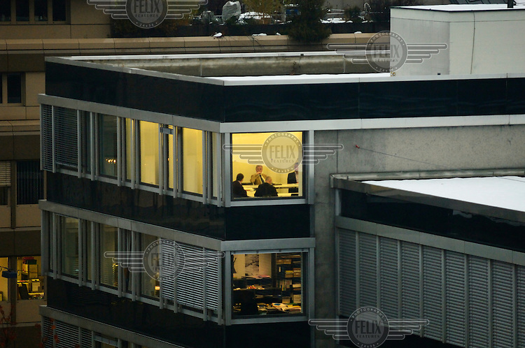 A meeting on an upper floor of the Zurich offices of a Liechtenstein bank. The Swiss banking industry holds an estimated 4,000 billion Swiss Francs (USD 4,240 billion) in assets, more than half of it foreign, including CHF 880 billion in undeclared European assets alone, benefiting from the country's famous banking secrecy laws...