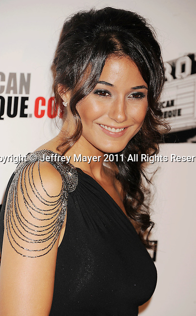 BEVERLY HILLS, CA - OCTOBER 14: Emmanuelle Chriqui arrives at the The 25th American Cinematheque Award Honoring Robert Downey Jr. at The Beverly Hilton hotel on October 14, 2011 in Beverly Hills, California.