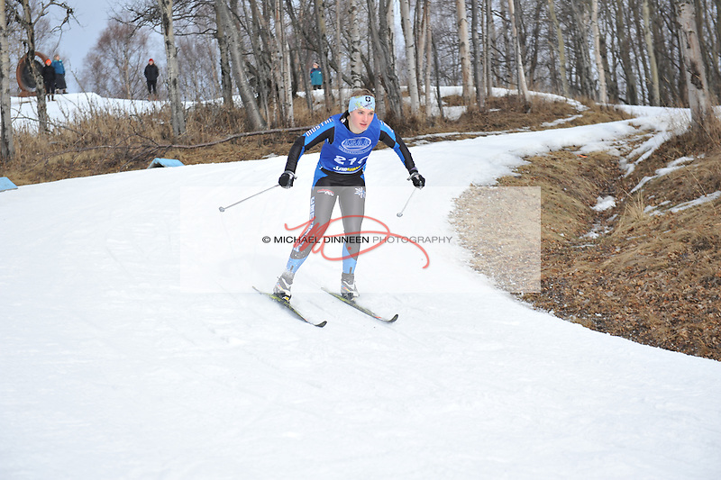 Chugiak's Hannah Booher negotiates a turn enroute to a 17 place finish in Friday's  classical race the during the state championships at Kincaid Park.  Photo for the Star by Michael Dinneen