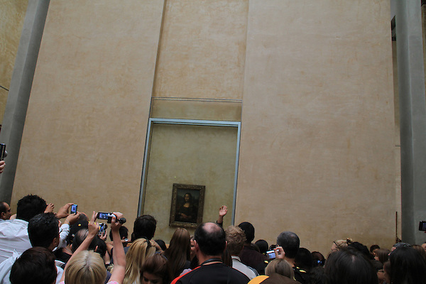 The Mona Lisa painting in the Louvre Museum in Paris, France.
