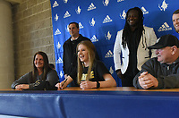 NWA Democrat-Gazette/FLIP PUTTHOFF<br />Skylurr Patrick (center) laughts with classmates during her scholarship ceremony Wednesday Feb. 7 at Rogers High School. Patrick will play soccer at Purdue University.