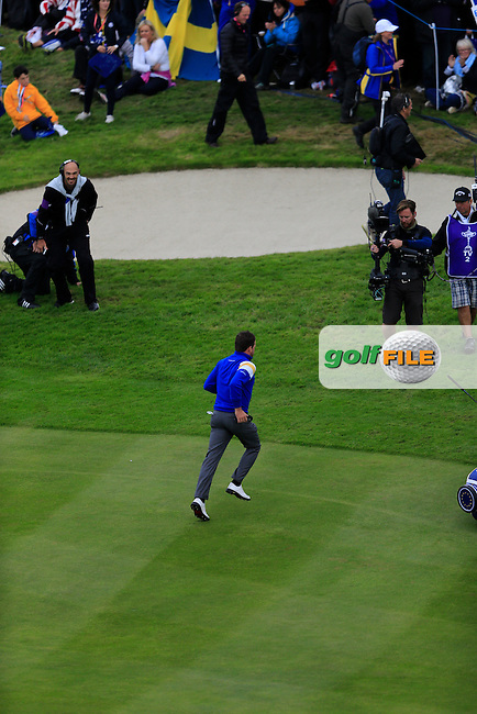 Graeme McDowell (EUR) on the 16th green during the Sunday Singles Matches at the 2014 Ryder Cup at Gleneagles. The 40th Ryder Cup is being played over the PGA Centenary Course at The Gleneagles Hotel, Perthshire from 26th to 28th September 2014.<br /> Picture:  Thos Caffrey / www.golffile.ie
