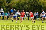 Eamon Kiely passes to his Flor McAulliffe Brosna despite the efforts of Desmonds Adam Donoghue  during their Intermediate Club Championship relegation play off in Cordal on Sunday