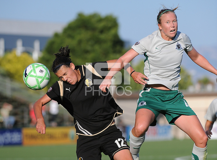 Christine Sinclair heads the ball towards goal as Sara Larrson, left, defends. .St. Louis Athletica over FC Gold Pride 1-0 at Buck Shaw Stadium, in Santa Clara, California, Sunday, July 5, 2009.