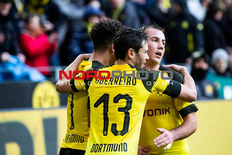 09.02.2019, Signal Iduna Park, Dortmund, GER, 1.FBL, Borussia Dortmund vs TSG 1899 Hoffenheim, DFL REGULATIONS PROHIBIT ANY USE OF PHOTOGRAPHS AS IMAGE SEQUENCES AND/OR QUASI-VIDEO<br /> <br /> im Bild | picture shows:<br /> Raphael Guerreiro (Borussia Dortmund #13) und Mario Goetze (Borussia Dortmund #10) jubeln mit dem Torsch&uuml;tzen Jadon Sancho (Borussia Dortmund #7) &uuml;ber dessen Treffer zum 1:0,  <br /> <br /> Foto &copy; nordphoto / Rauch