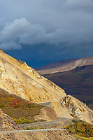 The Denali park road winds along the precipitous ridge of Polychrome pass in Denali National Park.