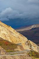 The Denali park road winds along the precipitous ridge of Polychrome pass in Denali National Park.