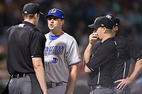 Durham Bulls manager Jared Sandberg (22) argues a call with home plate umpire Eric Gillam as first base umpire Brian Peterson (right) looks on during the game against the Charlotte Knights at BB&T BallPark on May 15, 2017 in Charlotte, North Carolina. The Knights defeated the Bulls 6-4.  (Brian Westerholt/Four Seam Images)