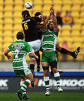 Wellington's Victor Vito and Daniel Ramsay compete for a high ball with Nick Crosswell. Air NZ Cup - Wellington Lions v Manawatu Turbos at Westpac Stadium, Wellington, New Zealand. Saturday 3 October 2009. Photo: Dave Lintott / lintottphoto.co.nz