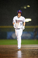 Buffalo Bisons third baseman Matt Dominguez (3) runs the bases in the pouring rain after hitting a home run during a game against the Lehigh Valley IronPigs on July 9, 2016 at Coca-Cola Field in Buffalo, New York.  Lehigh Valley defeated Buffalo 9-1 in a rain shortened game.  (Mike Janes/Four Seam Images)