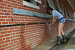 A girl washing herself outside the cow barn at the Wisconsin State Fair in West Allis, Wisconsin on August 3, 2008.