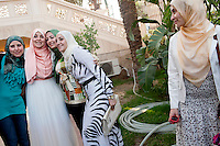 Manar, a Sister, takes pictures with friends following her wedding in El Rahman El Rahim Mosque, in Abbasseya, Cairo, Egypt. July 14th, 2012.