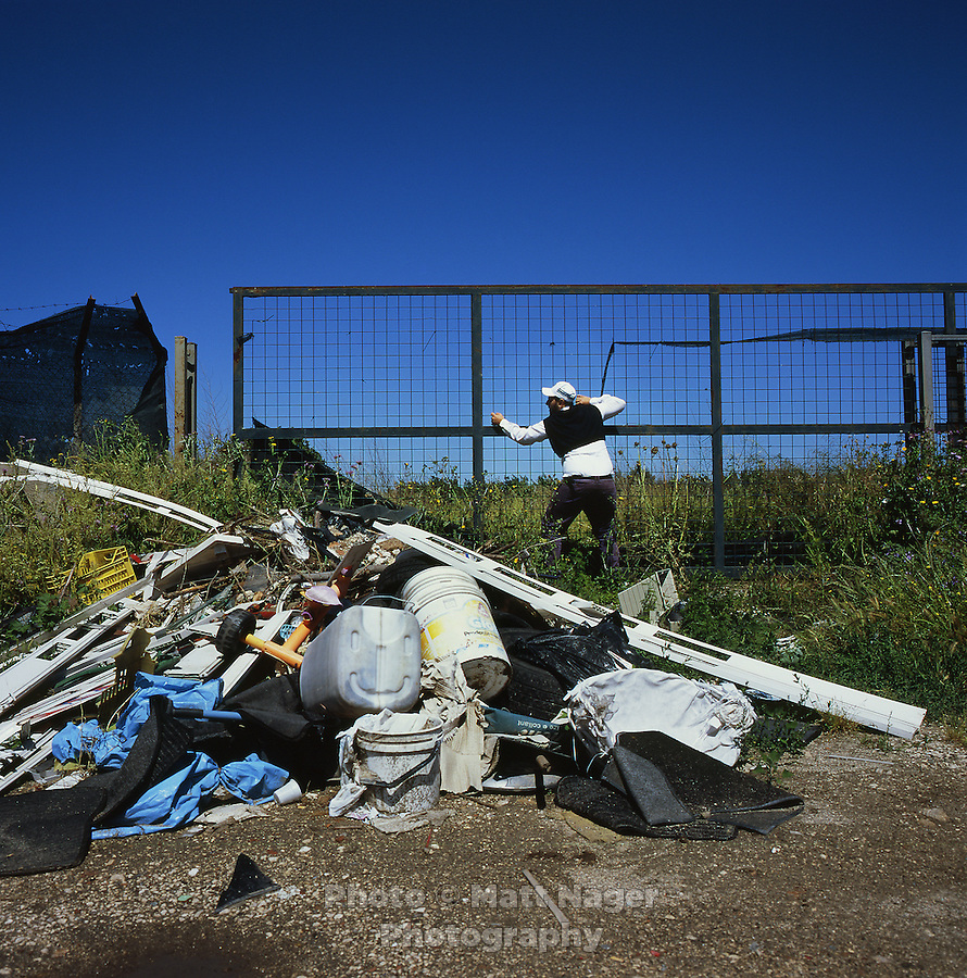 "Alessandro Cannavacciuolo opens a gate leading into an old farm used as an illegal dumping ground for trash including televisions, computers, and toxic chemicals in Calbricito near Acerra, Italy. This waste will unlikely be removed or treated to lessen toxicity levels as the area has been deemed ""secured"" by government officials. Surrounding farms have seen a drop in production quality of produce...PHOTOS/ MATT NAGER"