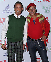 HOLLYWOOD, CA - DECEMBER 01: Johnny Chaillot, Greg Louganis arriving at the 82nd Annual Hollywood Christmas Parade held at Hollywood Boulevard on December 1, 2013 in Hollywood, California. (Photo by Xavier Collin/Celebrity Monitor)