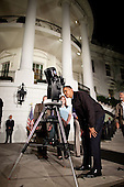 Washington, DC - October 7, 2009 -- United States President Barack Obama looks through a telescope during the Astronomy Night event on the South Lawn of the White House, October 7,  2009.  .Mandatory Credit: Chuck Kennedy - White House via CNP
