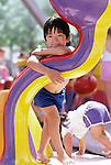 Expo 86 Vancouver BC young kid playing in water park with other kids portrait