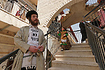 Israel, Jerusalem. Purim holiday at the Ultra Orthodox Me?a She?arim quarter, the Hassid is displaying his shirt saying ?A non Zionist Jew? 2005<br />