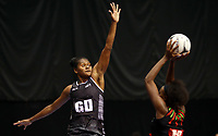 22.02.2018 Fiji's Alisi Naqiri and Malawi's Mwai Kumwenda in action during the Fiji v Malawi Taini Jamison Trophy netball match at the North Shore Events Centre in Auckland. Mandatory Photo Credit ©Michael Bradley.