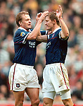 Richard Gough celebrates victory over Celtic with Jonas Thern in November 1997 at Ibrox