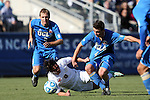 14 December 2014: Virginia's Pablo Aguilar (GUA) (8) grabs the jersey of UCLA's Grady Howe (4). The University of Virginia Cavaliers played the University of California Los Angeles Bruins at WakeMed Stadium in Cary, North Carolina in the 2014 NCAA Division I Men's College Cup championship match.