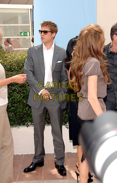 "BRAD PITT & ANGELINA JOLIE.""A Mighty Heart"" photocall at the 60th International Cannes Film Festival, Cannes, France. .May 21st, 2007 .full length sunglasses shades couple grey gray suit brown top.CAP/PL.©Phil Loftus/Capital Pictures"