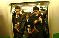 Businessmen during the frantic and busy rush hour period in Otemachi, Tokyo.