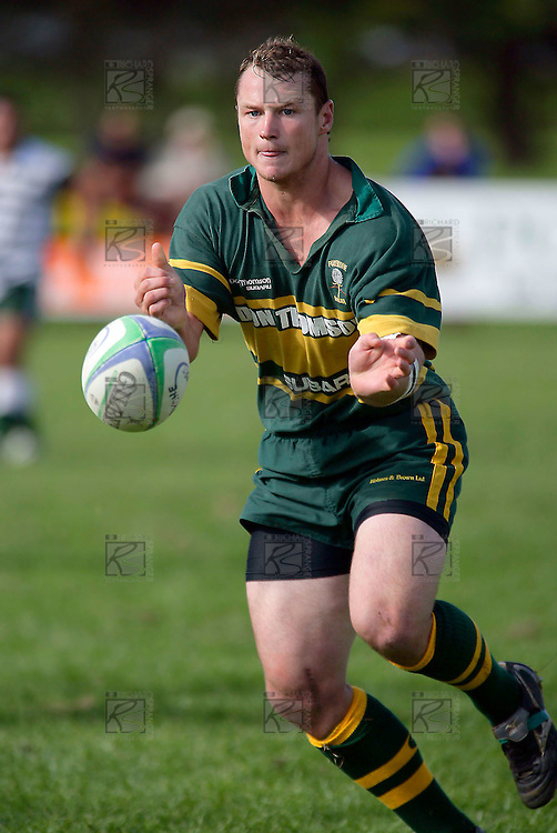 Kevin Farrell passes after making a strong run.Counties Manukau Premier Club Rugby, Pukekohe v Manurewa  played at the Colin Lawrie field, on the 17th of April 2006. Manurewa won 20 - 18.