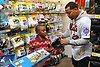Dominic Smith, New York Mets rookie first baseman, helps David Oche, 7, pick out socks during the team's Holiday Shopping Spree at Target in Elmhurst, NY on Wednesday, Nov. 29, 2017.
