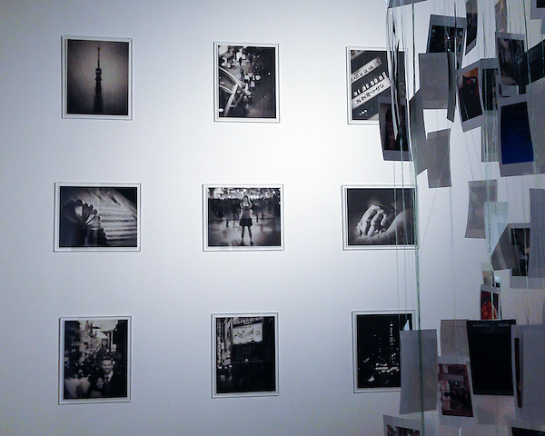 """Living a Dream"" exhibition in Tokyo comprising nine prints and an installation. Over 200 small size photographs were used for the installation."