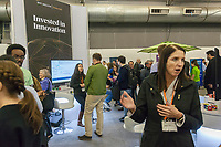 Workers from BNY Mellon speak to attendees at the TechDay New York event on Tuesday, April 18, 2017. Thousands attended to seek jobs with the startups and to network with their peers. TechDay bills itself as the U.S.'s largest startup event with over 500 exhibitors. (© Richard B. Levine)