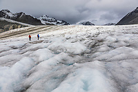 Hikers travel along the Gulkana Glacier in the Alaska Range mountian.
