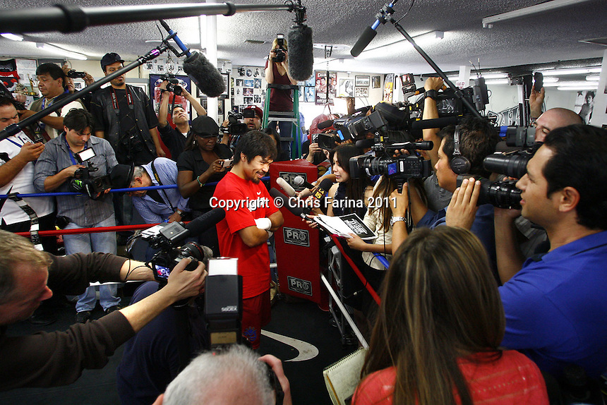 "April 20, 2011, Hollywood,Ca. ---  Superstar Manny Pacquiao speaks to a jam-packed,standing room only media day at the Wildcard Boxing Club in Hollywood Wednesday in preparation for his upcoming World Welterweight mega fight against ""Sugar"" Shane Mosley on Saturday, May 7 at the MGM Grand in Las Vegas.  Pacquiao vs Mosley is promoted by Top Rank in association with MP Promotions,Sugar Shane Mosley Promotions,Tecate and MGM Grand.  The Pacquiao vs Mosley telecast will be available live on SHOWTIME Pay Per View.  --- Photo Credit : Chris Farina - Top Rank  (no other credit allowed)  copyright 2011"