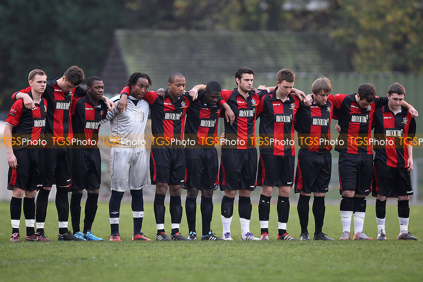 Romford players observe a one minute silence before kick-off - Waltham Forest vs Romford - Ryman League Division One North Football at Cricklefields Stadium - 12/11/11 - MANDATORY CREDIT: Gavin Ellis/TGSPHOTO - Self billing applies where appropriate - 0845 094 6026 - contact@tgsphoto.co.uk - NO UNPAID USE.