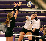 SIOUX FALLS, SD - SEPTEMBER 23: Kate Hart #11 from University of Sioux Falls looks to get a kill past Katie Hughes #8 from Wayne State Tuesday night at the Stewart Center.  (Photo by Dave Eggen/Inertia)