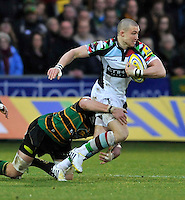 Northampton, England. Mike Brown of Harlequins tacked during the Aviva Premiership match between Northampton Saints and Harlequins at Franklin's Gardens on December 22. 2012 in Northampton, England.