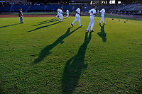 Columbia Fireflies position players warm up before a game against the Charleston RiverDogs on Tuesday, August 28, 2018, at Spirit Communications Park in Columbia, South Carolina. (Tom Priddy/Four Seam Images)