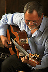 Close up of Gil Gutierrez (Guitar) as he performed with Bob Stern (violin) at Opus 40, in Saugerties, NY, on May 9, 2015. Photo by Jim Peppler. Copyright Jim Peppler 2015.