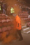 Steward dealing with smoke bomb after being thrown by Hull City supporters during the Sky Bet Championship League match at The Riverside Stadium.  Photo credit should read: Jamie Tyerman/Sportimage