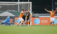 Houston Dynamo forward Brian Ching (25) celebrates his score to rie the game in the 89th minute of the game.    Houston Dynamo tied DC United 2-2, at RFK Stadium, Saturday June 25, 2011.