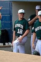 Dartmouth Big Green Pitcher Adam Frank (12) in the dugout during a game against the Long Island Blackbirds at Chain of Lakes Stadium on March 17, 2013 in Winter Haven, Florida.  Dartmouth defeated UAB 11-4.  (Mike Janes/Four Seam Images)