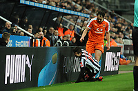 Danny Hylton of Luton Town pushes Javi Manquillo of Newcastle United into the advertising boards during Newcastle United vs Luton Town, Emirates FA Cup Football at St. James' Park on 6th January 2018
