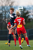 Sky Blue FC midfielder Sophie Schmidt (16) goes up for a header with Western New York Flash midfielder McCall Zerboni (7). Sky Blue FC defeated the Western New York Flash 1-0 during a National Women's Soccer League (NWSL) match at Yurcak Field in Piscataway, NJ, on April 14, 2013.