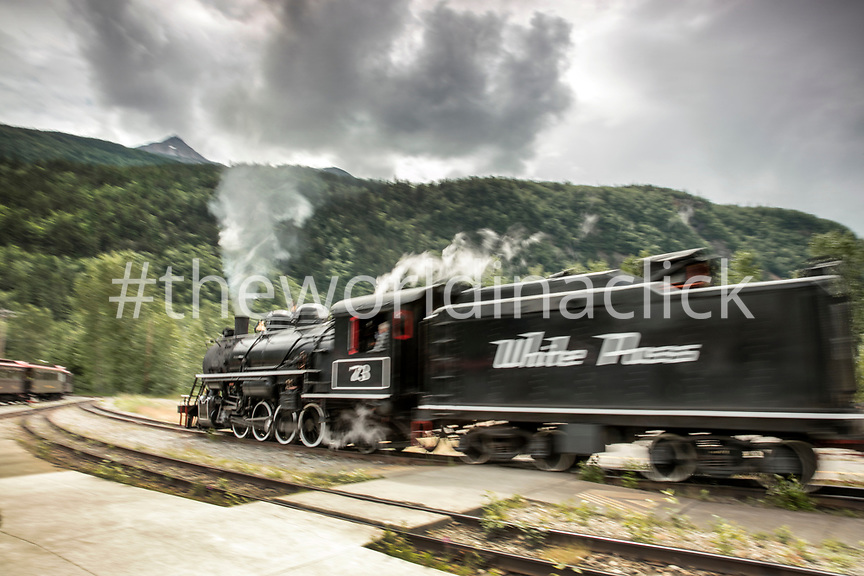 USA, Alaska, Sitka, the White Pass Steam Engine, number 73, prepares to pull into the station, the White Pass & Yukon Route Railroad climbs nearly 3,000 feet in just twenty miles from the town of Sitka up and into Canada