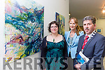 Artist Diana Muller Sneem shows her art to Kerry Mayor Michael O'Shea and Kate Kennelly at the Kerry Visual Artists Showcase exhibition in the Department of Art on Friday night