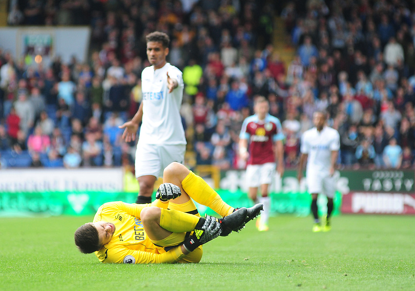 Swansea City's Lukasz Fabianski holds his right ankle after he had tackled Burnley's Scott Arfield<br /> <br /> Photographer Chris Vaughan/CameraSport<br /> <br /> Football - The Premier League - Burnley v Swansea City - Saturday 13th August 2016 - Turf Moor - Burnley<br /> <br /> World Copyright &copy; 2016 CameraSport. All rights reserved. 43 Linden Ave. Countesthorpe. Leicester. England. LE8 5PG - Tel: +44 (0) 116 277 4147 - admin@camerasport.com - www.camerasport.com