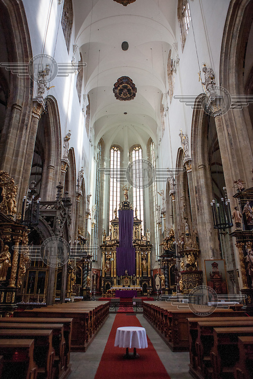 The interior of the Church of Our Lady before Tyn, a stronghold of followers of Jan Hus who controlled the church for over 200 years after his death.  <br /> Jan Hus (or John Huss, 1369 - 1415) was a Czech priest, philosopher and one of the first church reformers. Hus attacked moral failings among the clergy and promoted some of the teachings of John Wycliffe (1331 - 1384), an English reformere who had been burned at the stake in 1384. Hus was excommunicated for his views in 1410 and burned at the stake as a heretic in Konstanz on 6 July 1415.