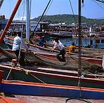 Busy fishermen with fishing nets, Pattaya beach,Thailand.